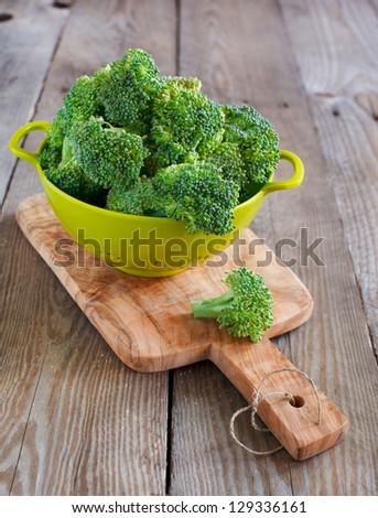 Broccoli on wooden board - stock photo