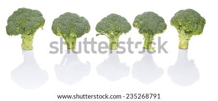 Broccoli over white background - stock photo