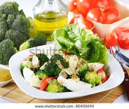 broccoli salad with tomatoes and eggs - stock photo