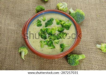 broccoli soup on jute background - stock photo