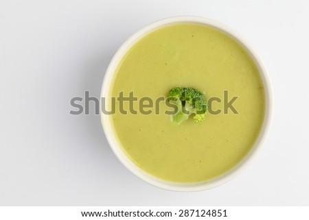 broccoli soup on white background - stock photo