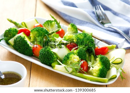 Broccoli with Asparagus,Zucchini and Rocket salad - stock photo