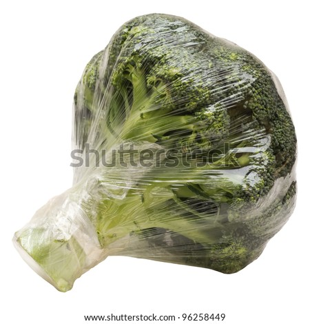 Broccoli wrapped in plastic foil isolated on white - stock photo