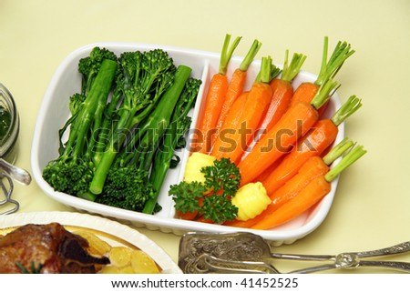 Broccolini and baby carrots ready to serve with lamb.