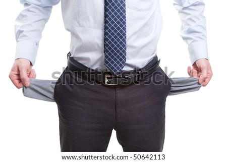 Broke business man with empty pockets isolated on white