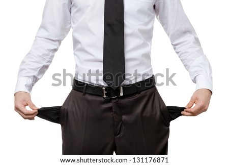 Broke business man with empty pockets, isolated on white. Financial crisis
