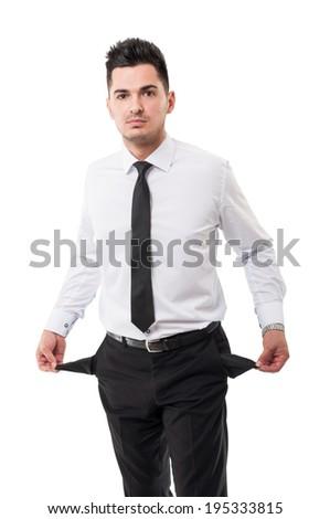 Broke businessman showing his empty pockets - stock photo