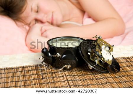 broken alarm-clock is result of unsuccessful awakening (focus on clock) - stock photo