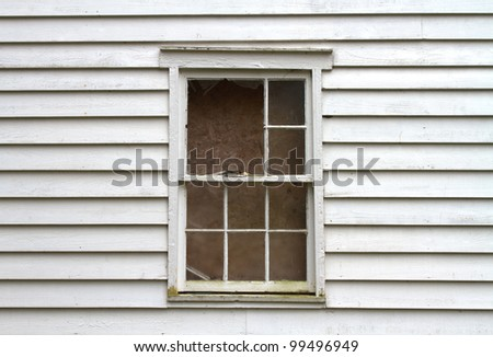 Broken and Boarded Window from Abandoned House
