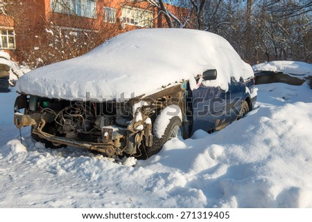 Broken and shattered car is worth in the snow - stock photo