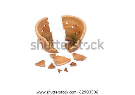 Broken antique clay pot on a white background - stock photo