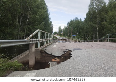 Broken asphalt on caused by heavy rain, Sweden - stock photo