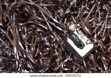 broken audio cassette with tape - stock photo