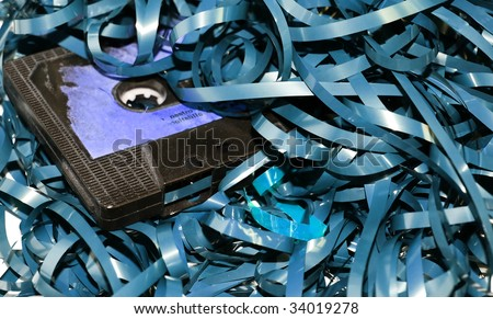 broken audio cassette with tape blue tone - stock photo