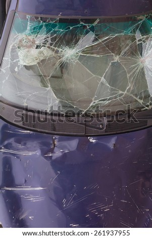 broken auto  car abandoned on the road. car wreck broken windshield - stock photo