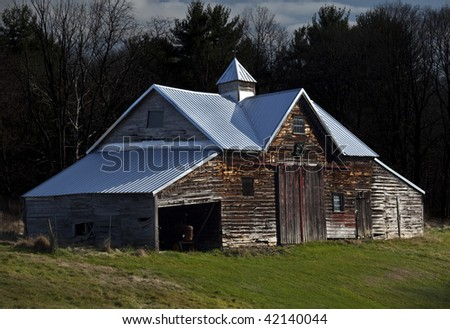 broken barn with Christmas decorations under sunset light