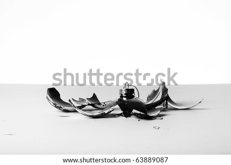 broken bauble on white background - stock photo