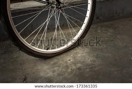 Broken bicycle wheel - stock photo
