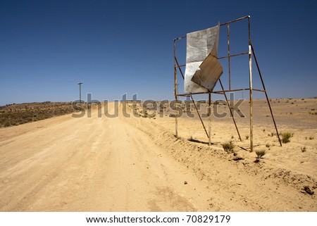 Broken billboard in desert - abandoned place - stock photo