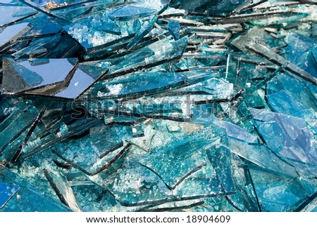Broken blue glass background - stock photo