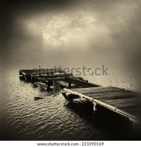Broken boat dock - stock photo