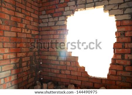 Broken bricks wall. Conceptual composition. - stock photo