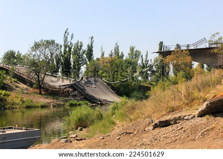 Broken bridge after bombing - stock photo