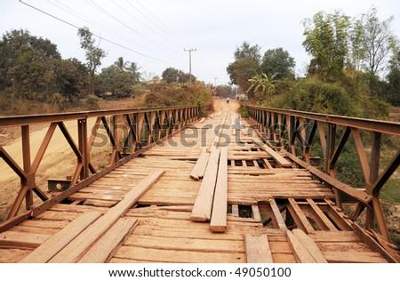 Broken bridge in a secondary road Laos - stock photo