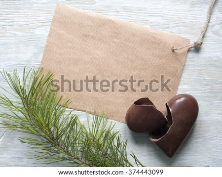 Broken brown heart and blank paper note for message on wood. - stock photo