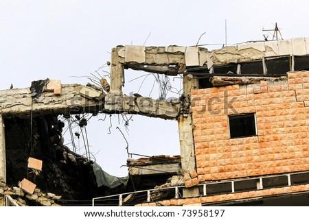 Broken building ruins after earthquake catastrophe destruction - stock photo