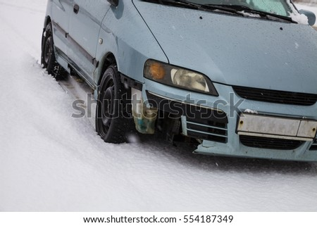Broken car bumper close up. Broken car on a winter road. Car accident.