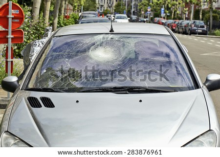 Broken Car Windshield from outside the car - stock photo