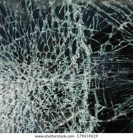 Broken car windshield made of laminated glass. Square composition. - stock photo