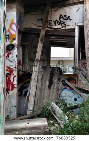 Broken cement asbestos roofing in derelict house. Hazardous waste in urban area. - stock photo