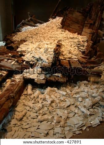 broken ceramics porcelain pieces lying on boat - stock photo