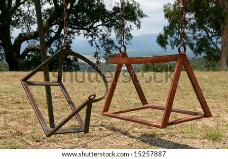 broken child's swing chair on a park - stock photo