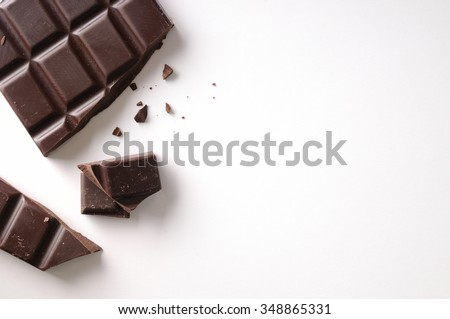 Broken chocolate bar left position isolated on white table. Horizontal composition. Top view - stock photo