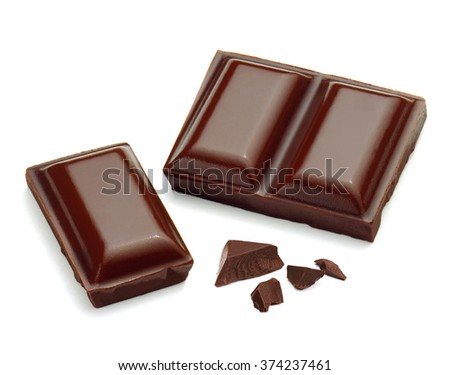 Broken chocolates and pieces on white background - stock photo