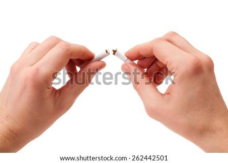 Broken cigarette in man hands,Stop smoking - stock photo