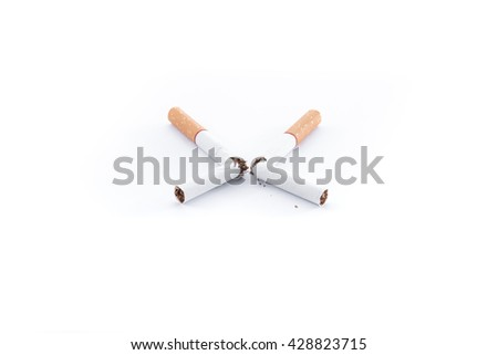 Broken Cigarette with brown filter on white background - stock photo
