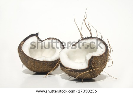 Broken coconut isolated on white - stock photo