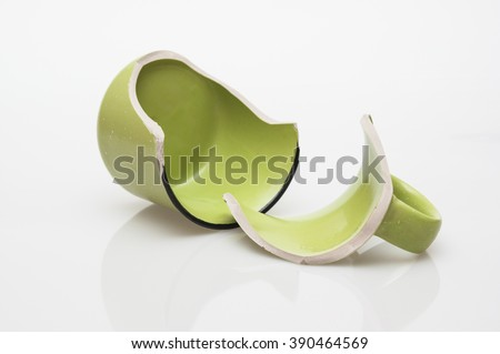 Broken coffee cup isolated on white background
