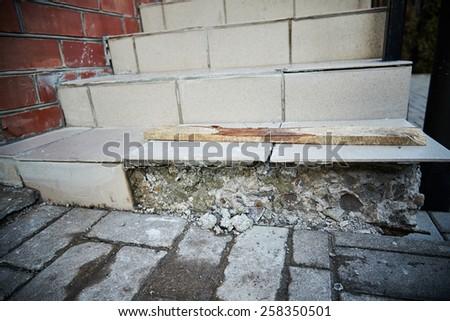 broken concrete staircase. broken entrance stairs.  - stock photo