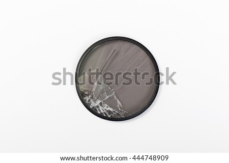 broken CPL lens isolated on white background