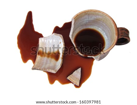 Broken cup with spilled coffee - stock photo