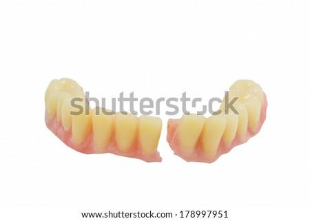 Broken denture - stock photo