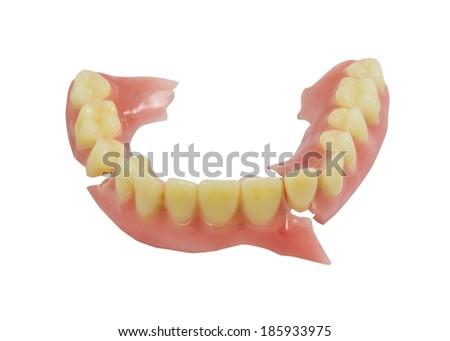 Broken denture isolate on white background - stock photo