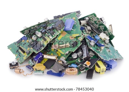 Broken destroyed cut pieces electronic printed-circuit boards and components on a dump - stock photo