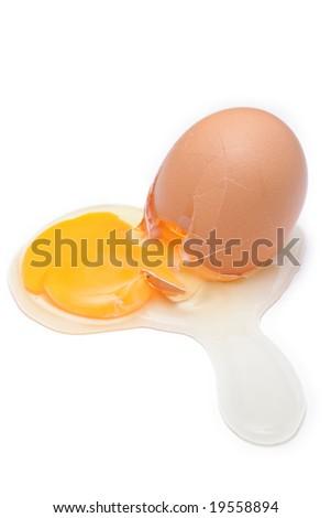 Broken egg isolated against white background - stock photo