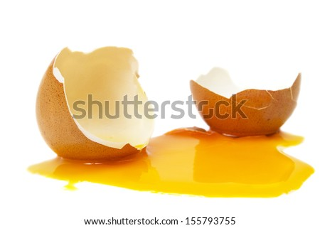 broken egg isolated on a white background - stock photo